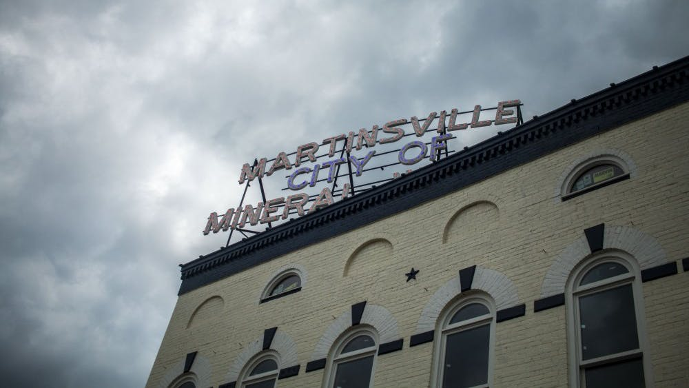 """A """"Martinsville City of Mineral Water"""" sign sits at the top of a building on the downtown square of Martinsville, Indiana. Carol Jenkins-Davis was murdered in 1968 in the 500 block of East Morgan Street, just blocks from the square."""
