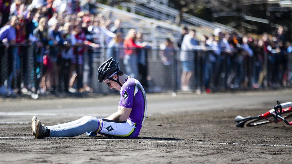 Then-junior Andrew Ross sits on the ground after a fault during the Little 500 Qualifications on March 23, 2019, at Bill Armstrong Stadium. Photographer Claire Livingston won College Photographer of the Year in the sports category from the Indiana News Photographers Association for this photo.