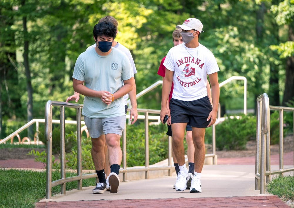 <p>Freshman walk through campus Aug. 24. The group wore their masks for the duration of their journey, which ended at the Indiana Avenue Starbucks.</p>