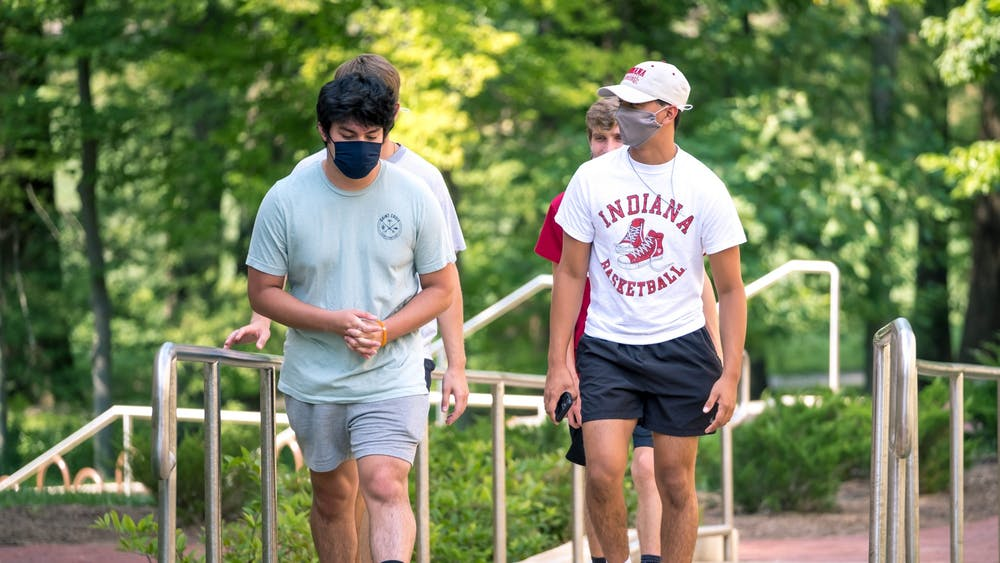 Freshman walk through campus Aug. 24. The group wore their masks for the duration of their journey, which ended at the Indiana Avenue Starbucks.