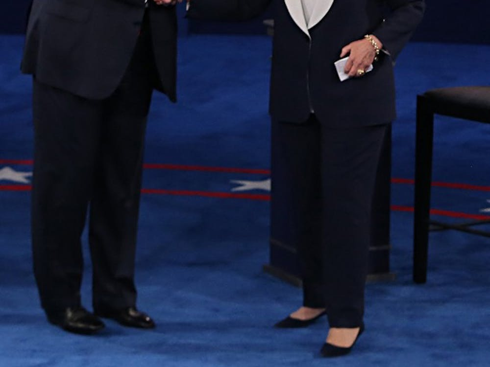 Donald Trump and and Hillary Clinton shake hands on stage after the second debate between the Republican and Democratic presidential candidates on Sunday, Oct. 9, 2016 at Washington University in St. Louis, Mo. Since sports are a key part of American society, it's important to consider the level of athleticism each candidate possesses.