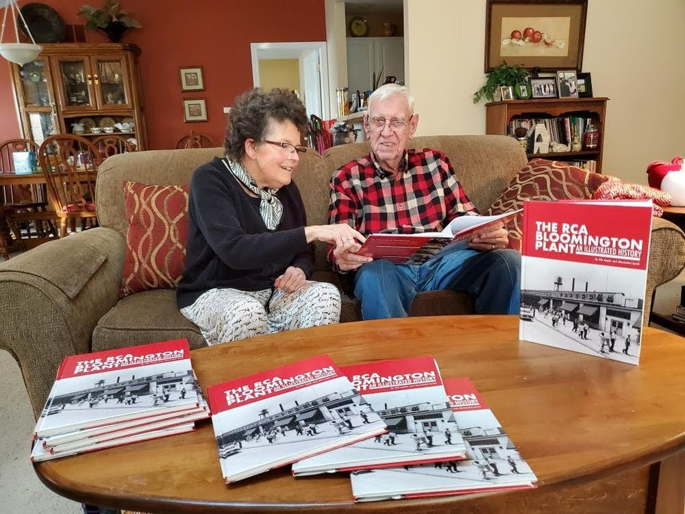 """Gib Apple and Sandy Lynch hold up their book, """"The RCA Bloomington Plant"""", in January. The book features a visual history of the Radio Corporation of America plant, which operated from 1940-1998."""