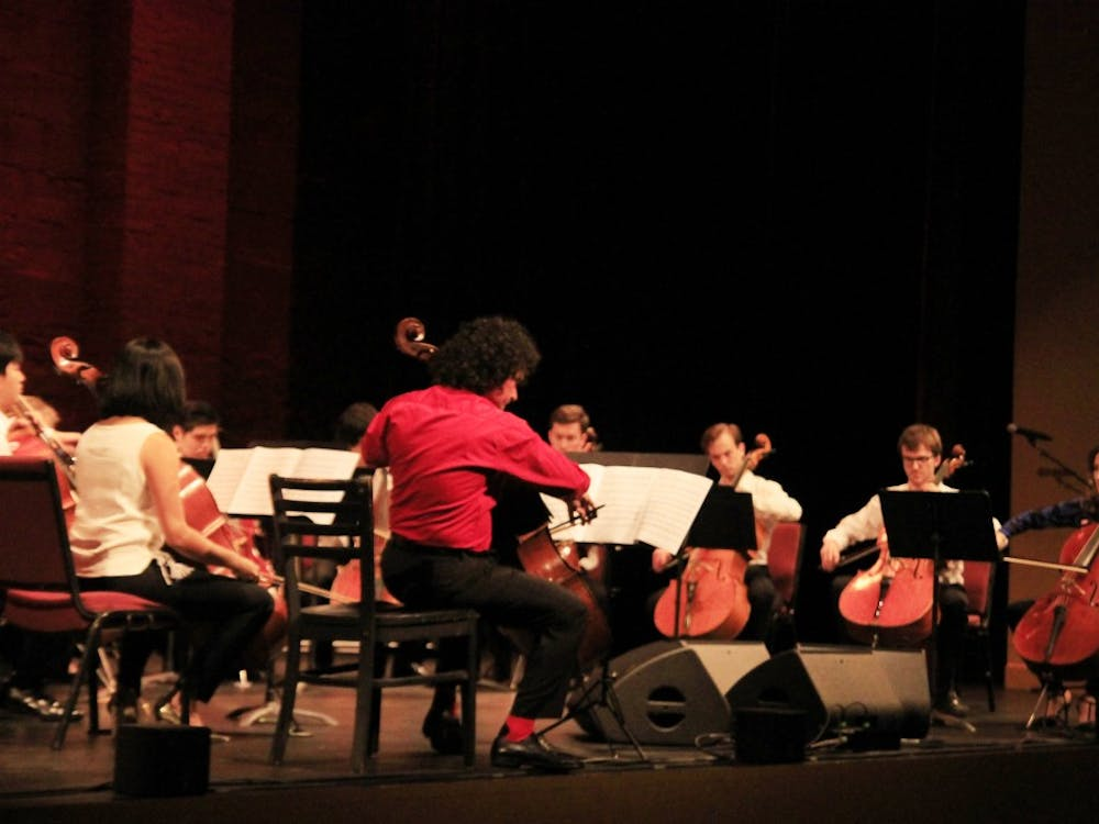 """Cellists from the studio of Emilio Colón play """"Suite del ángel"""" by Astor Piazzolla at the De Pueblo a Pueblo benefit concert Monday at the Buskirk-Chumley Theater. Colón also spoke about his travels to Puerto Rico to donate food and help families affected by Hurricane Maria."""