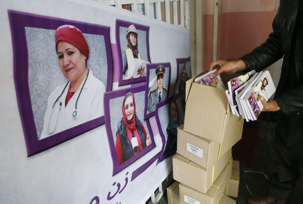 <p>An employee at the U.S. Embassy in Kabul, Afghanistan, prepares a display to celebrate Women's History Month. IU student leaders in Women and Co. and Women in Media said they believe in the importance of using women-focused groups to continue the conversation around women&#x27;s experiences. </p>