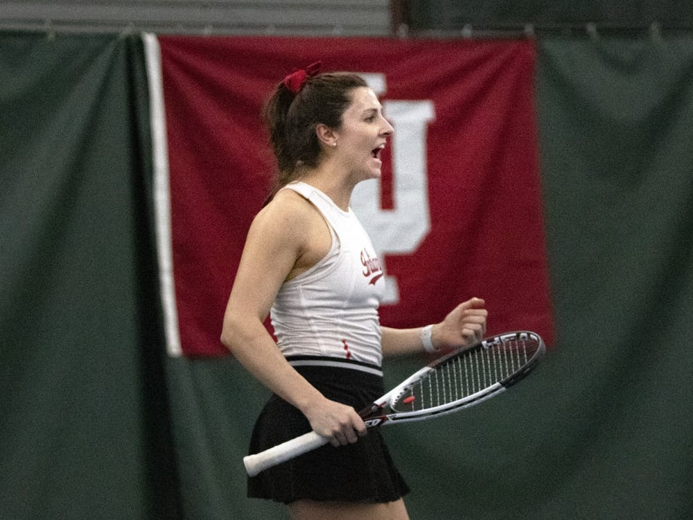 Senior Michelle McKamey cheers after scoring a point March 1 in the IU Tennis Center. IU defeated Penn State 4-1.