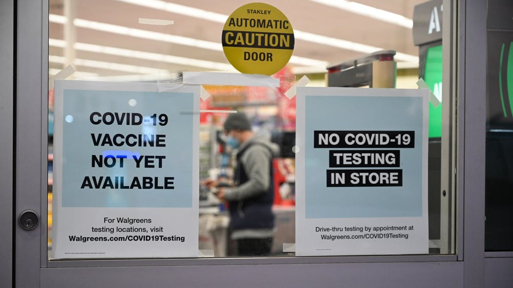 "A sign on the entrance to a pharmacy reads ""COVID-19 Vaccine Not Yet Available,"" Nov. 23 in Burbank, California. Moderna Inc. plans to request clearance for its coronavirus vaccine in the U.S. and Europe this month."