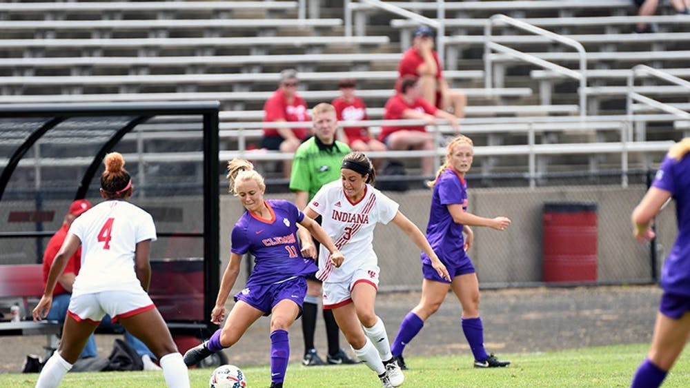 Junior forward Abby Allen (right) fights with Kimber Haley of Clemson for the ball at Bill Armstrong Stadium in August. Allen and the Hoosiers earned one point this weekend after losing to Minnesota and drawing with Wisconsin.