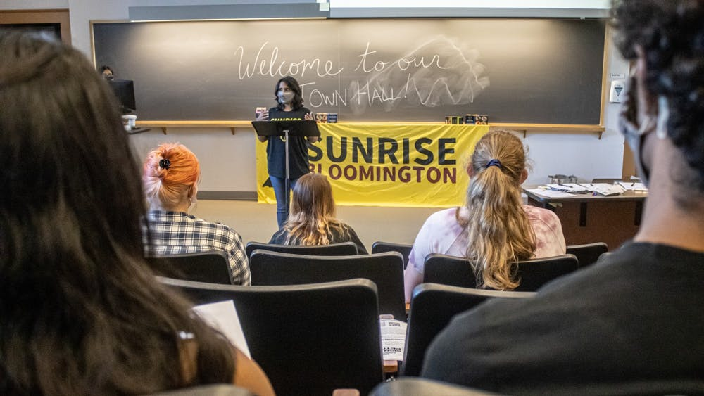 Ph.D. candidate Anushka Sen speaks during Sunrise Bloomington's town hall Sept. 8, 2021, at the Lee Norvelle Theatre and Drama Center. The group launched a campaign to promote a shift from fossil fuels at IU.
