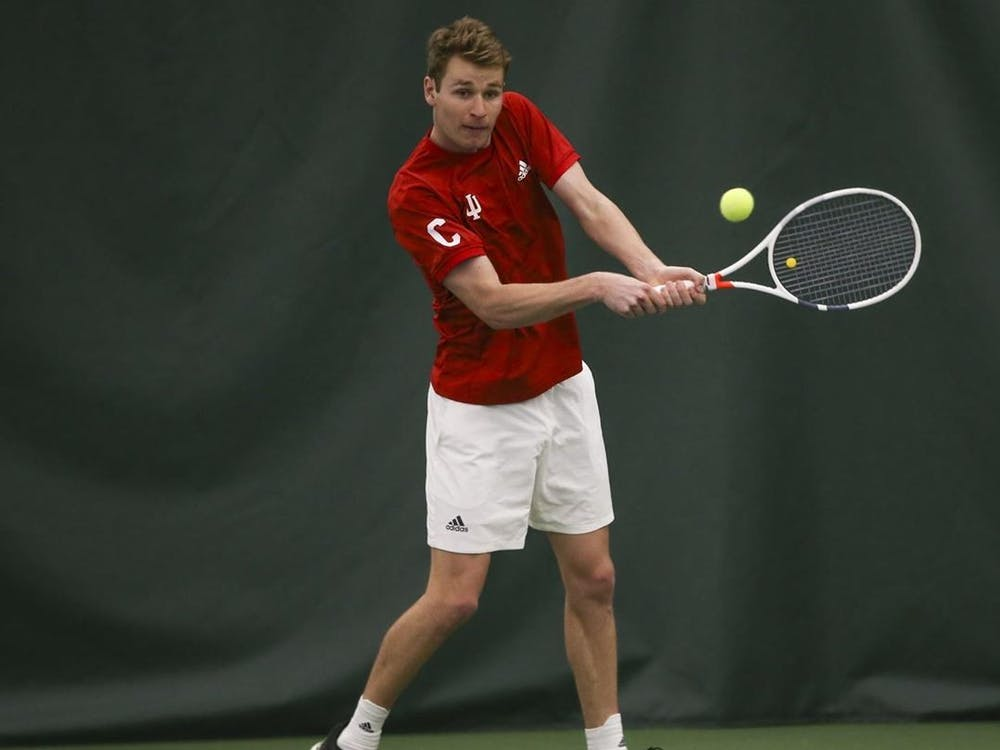 IU graduate student Bennett Crane swings his racket in a game against Michigan on April 3. Crane was named First Team All-Big Ten last Tuesday.