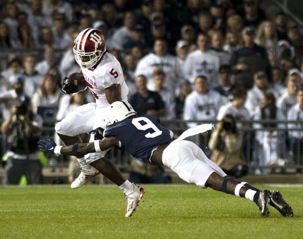 <p>Graduate running back Stephen Carr attempts to elude a tackler against Penn State on Oct. 2, 2021, at Beaver Stadium. Indiana has a bye this week.</p>
