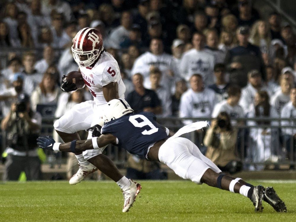 Graduate running back Stephen Carr attempts to elude a tackler against Penn State on Oct. 2, 2021, at Beaver Stadium. Indiana has a bye this week.