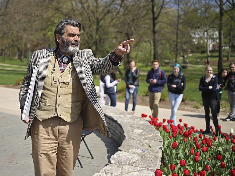 Brother Jed preaches April, 22, 2015, on campus. The audience threw questions back at him, heckling his condemnations.