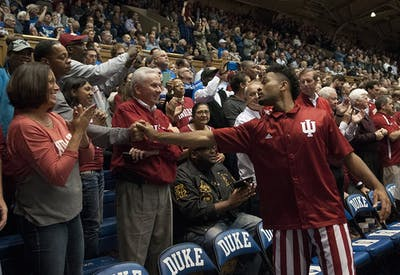 Sophomore guard James Blackmon, Jr. shakes hands with his dad James Blackmon, Sr. before the game against Duke on Dec. 2 at Cameron Indoor Stadium in Durham.