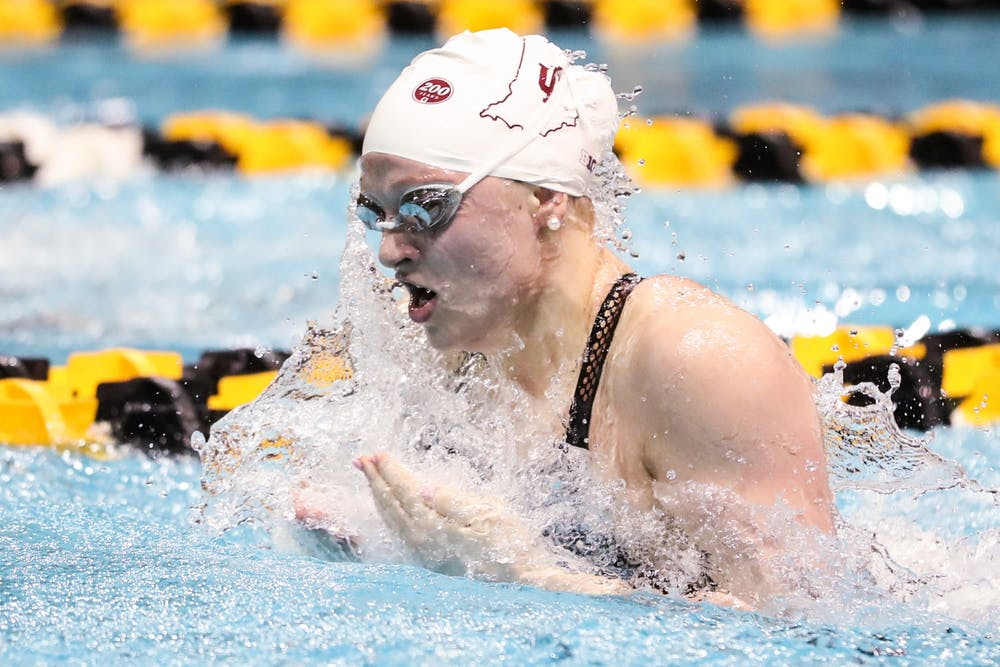 <p>Then-freshman Emily Weiss swims Feb. 21 during the Big Ten Championships at Campus Recreation and Wellness Center in Iowa City, Iowa. Weiss said she has trained at a friend's pool, a lake in Yorktown, Indiana, Monroe Lake in Bloomington and IU's club pool in Martinsville, Indiana, since the season ended in March.</p>