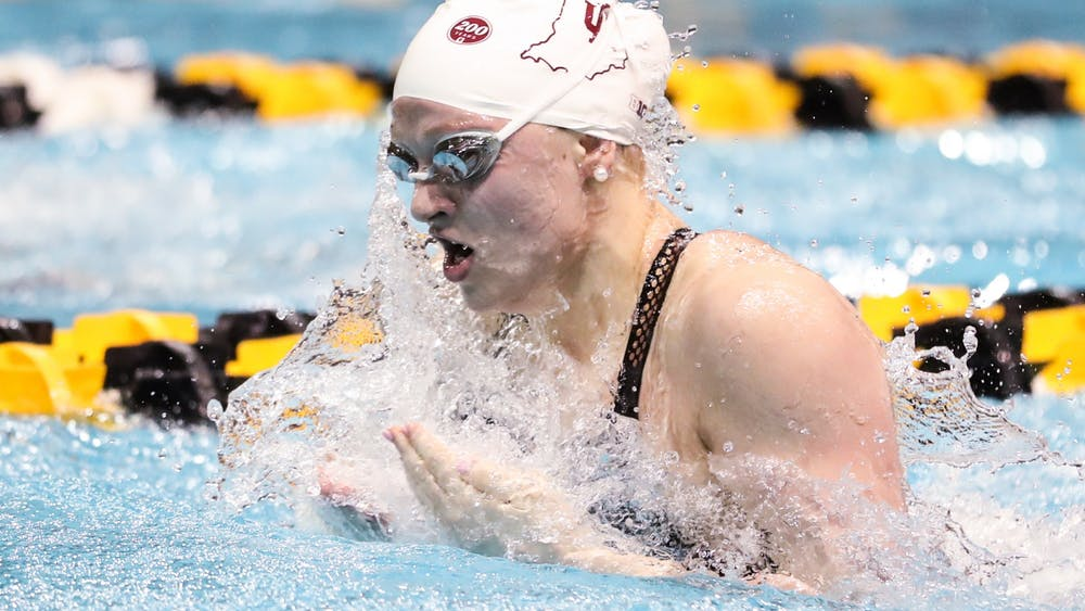 Then-freshman Emily Weiss swims Feb. 21 during the Big Ten Championships at Campus Recreation and Wellness Center in Iowa City, Iowa. Weiss said she has trained at a friend's pool, a lake in Yorktown, Indiana, Monroe Lake in Bloomington and IU's club pool in Martinsville, Indiana, since the season ended in March.