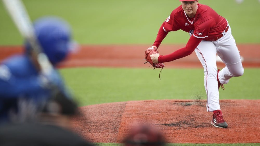 Junior Tim Herrin pitches the ball during the Hoosiers' game against the Indiana State Sycamores on Tuesday, April 10. IU defeated Nebraska 8-6 on Sunday.