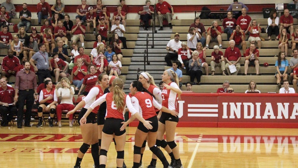 The Indiana Hoosiers cheers as they successfully earn a point during the volleyball competition against the Northwestern on Wednesday.