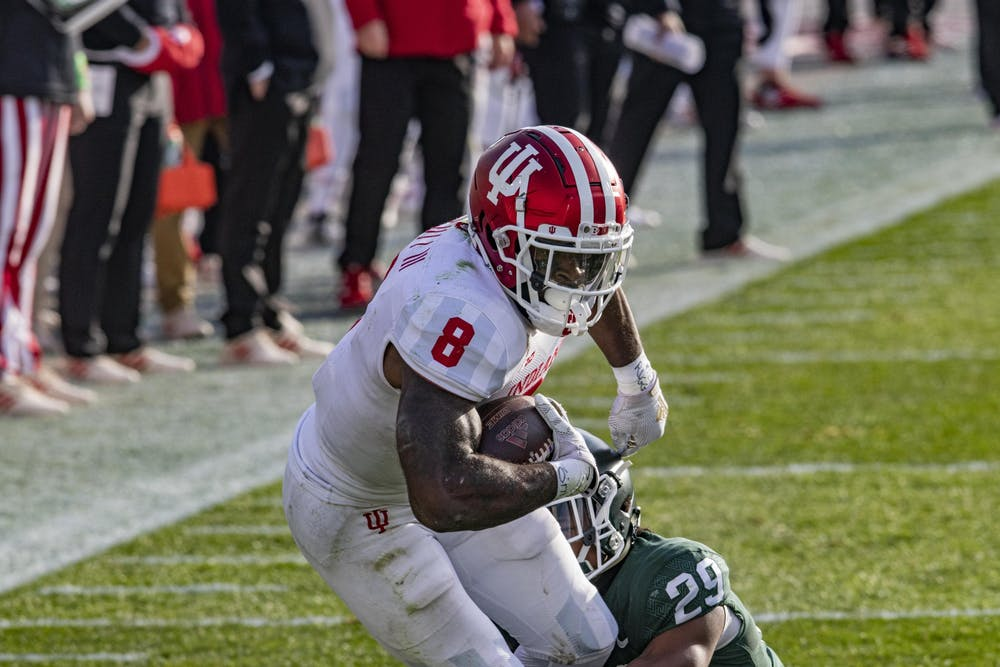 <p>Junior running back Stevie Scott III runs with the ball Nov. 14 in Spartan Stadium in East Lansing, Michigan. The Big Ten changed the conference title game requirements to benefit Ohio State on Wednesday, despite previously not changing conference rules to allow Nebraska an extra nonconference game in October.</p>