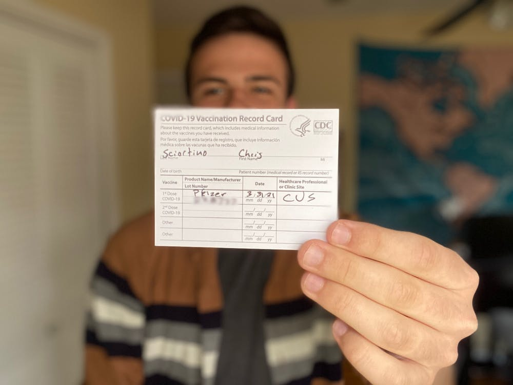 <p>Indiana Daily Student columnist Chris Sciortino holds his COVID-19 vaccination record card March 31. Indiana&#x27;s eligibility requirement expanded Wednesday to include everyone 16 years and older. </p>