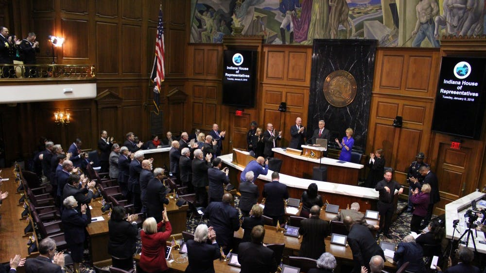 The members of the Indiana General Assembly stand up and cheer as Gov. Eric Holcomb finishes his State of the State speech. Holcomb's thirty-minute speech introduced his goals for the state this year.