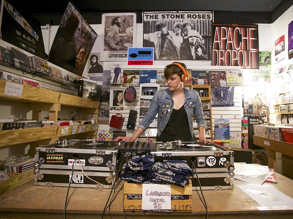 DJ Ann Jonker plays LPs on April 19, 2015, during the Record Store Day celebration at Landlocked Music. The store will celebrate Record Store Day on April 13 with live music and exclusive vinyl releases.