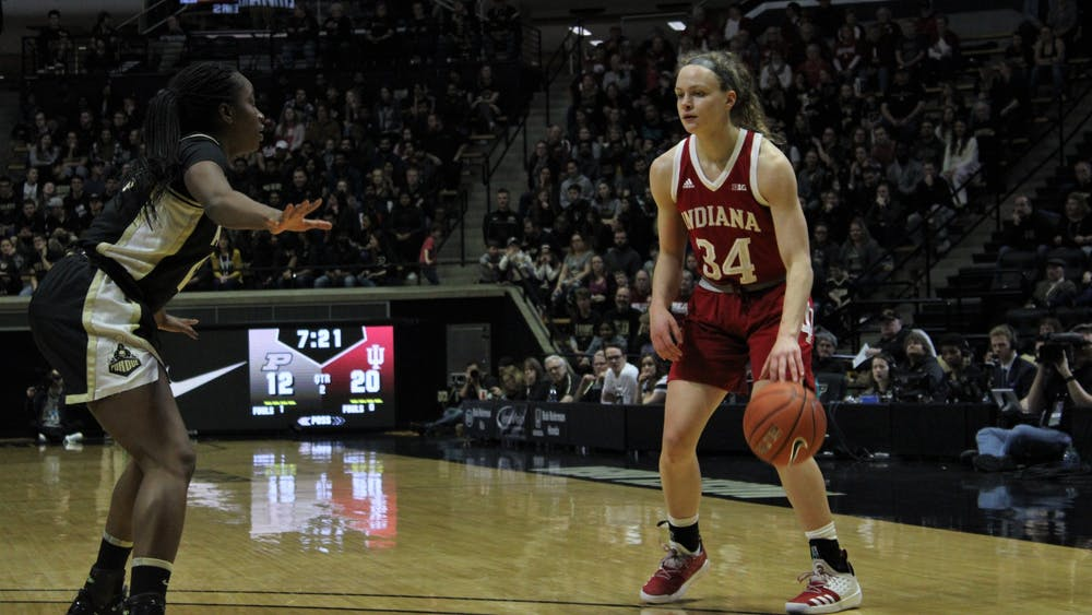 Sophomore guard Grace Berger dribbles the ball Feb. 3 in Mackey Arena. Berger scored 15 of IU's 66 points during the team's victory over Purdue.