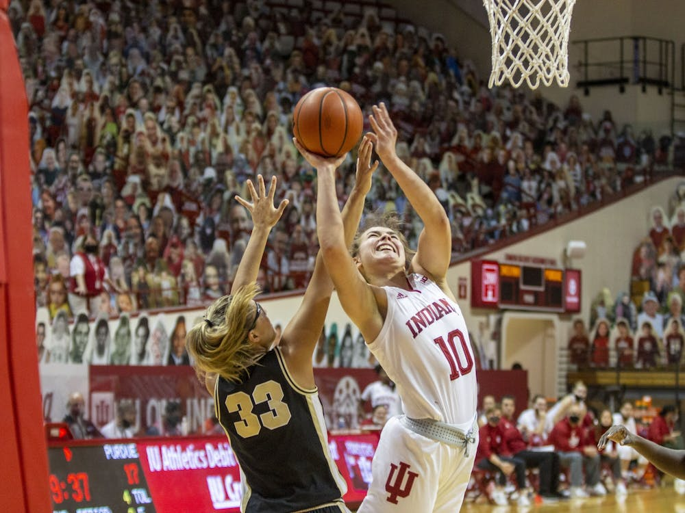 Junior forward Aleksa Gulbe attempts a layup Saturday at Simon Skjodt Assembly Hall. No. 11 Indiana will play in the Big Ten Tournament starting Thursday in Indianapolis.
