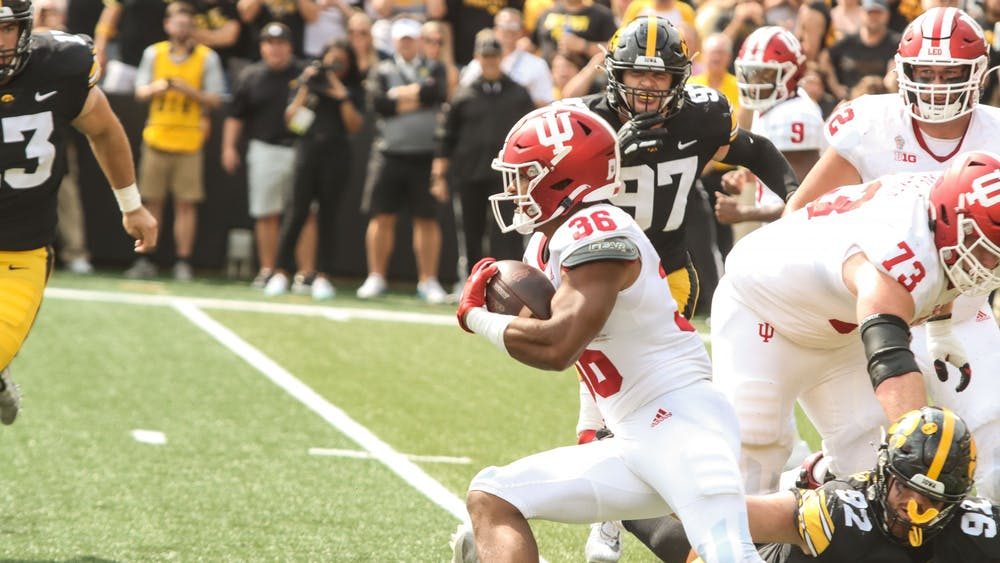 Redshirt junior running back Chris Childers moves up the field Sep. 4, 2021, at Kinnick Stadium in Iowa City. Childers had 14 yards on two rushing attempts against Iowa.