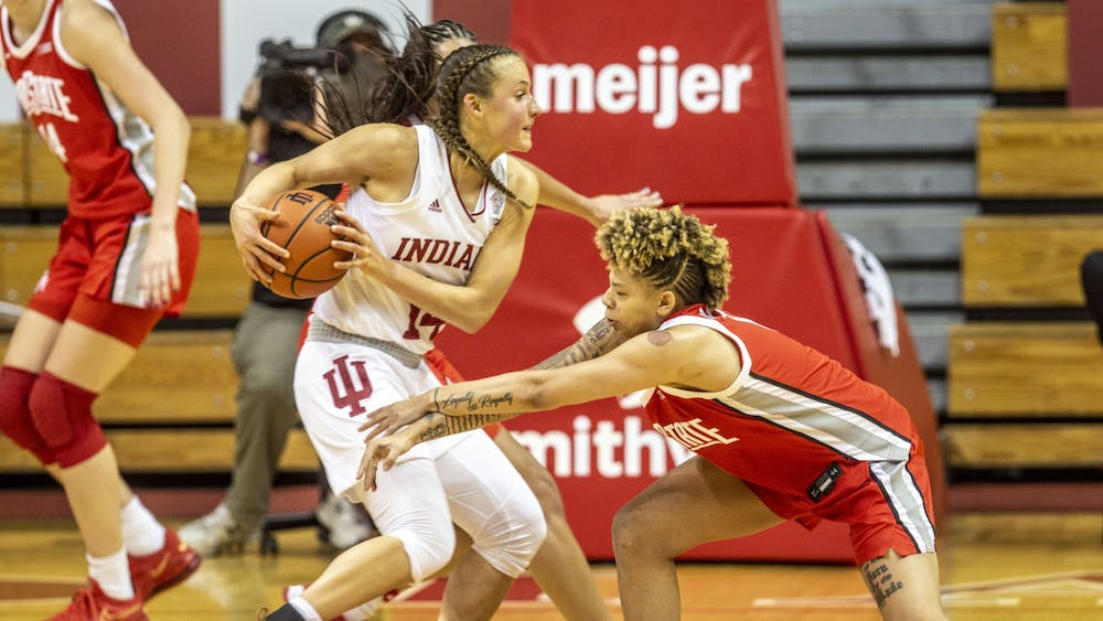 Redshirt senior guard Ali Patberg moves the ball around an Ohio State defender Jan. 28 in Simon Skjodt Assembly Hall. No. 16 IU lost to No. 14 Ohio State 78-70 for its second Big Ten loss of the season.