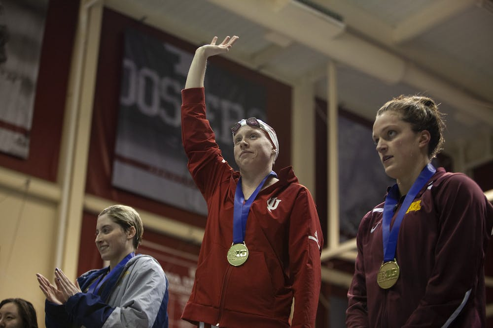<p>Then-senior Lilly King waves to the crowd during the award ceremony Feb. 22, 2019, in the Counsilman Billingsley Aquatic Center in the Student Recreational Sports Center. King won two gold medals in the 2016 Rio De Janeiro Olympic Games.</p>