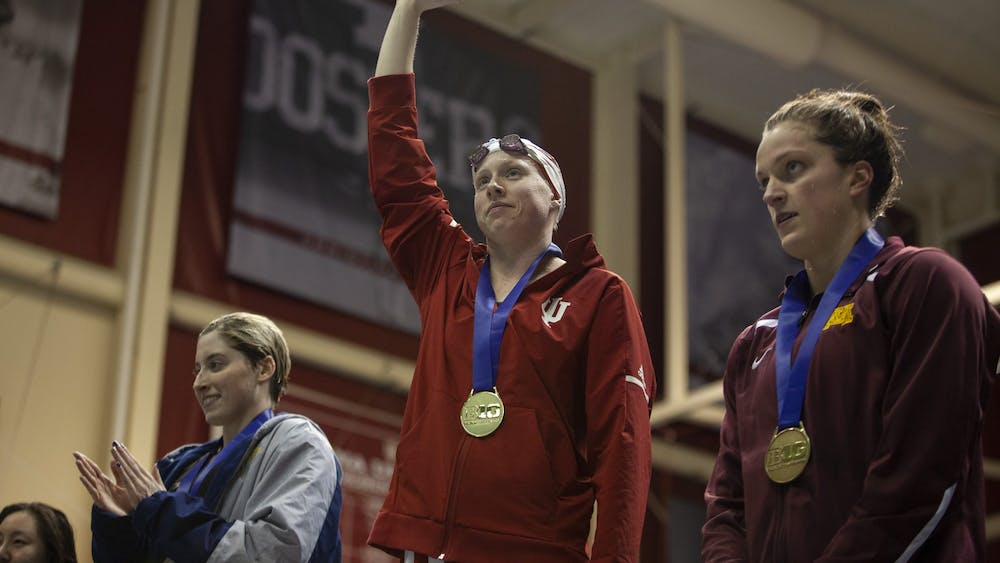 Then-senior Lilly King waves to the crowd during the award ceremony Feb. 22, 2019, in the Counsilman Billingsley Aquatic Center in the Student Recreational Sports Center. King won two gold medals in the 2016 Rio De Janeiro Olympic Games.