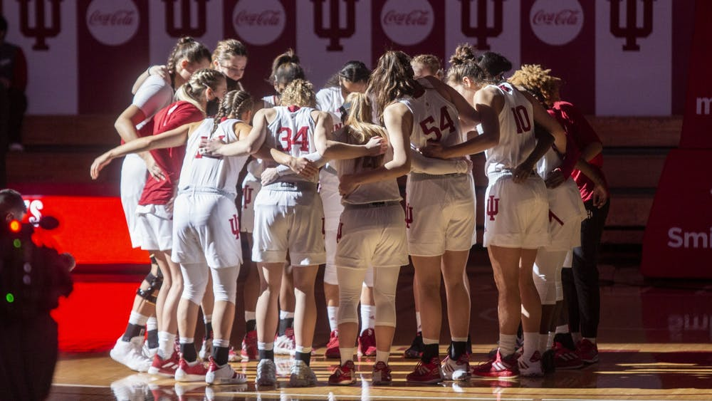 The IU women's basketball team huddles before the start of its game against Wisconsin on Jan. 10 in Simon Skjodt Assembly Hall. No. 19 IU defeated Wisconsin 74-49 to move to 5-1 in the Big Ten and 7-3 on the season.