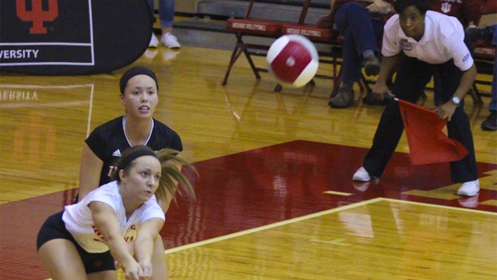 Senior defensive specialist Kyndall Merritt hits the volleyball on Saturday evening at University Gym. Hoosiers falls three sets to No.8 Nebraska.