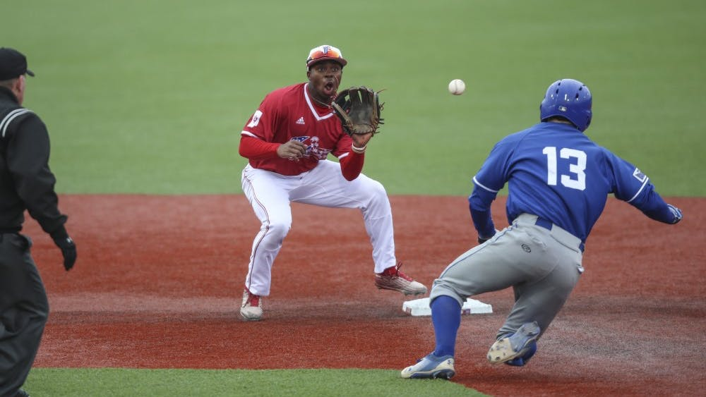 Sophomore Jeremy Houston catches the ball to tag the out during the Hoosiers' game against the Indiana State Sycamores. IU will play Illinois Wednesday night in the Big Ten Tournament.