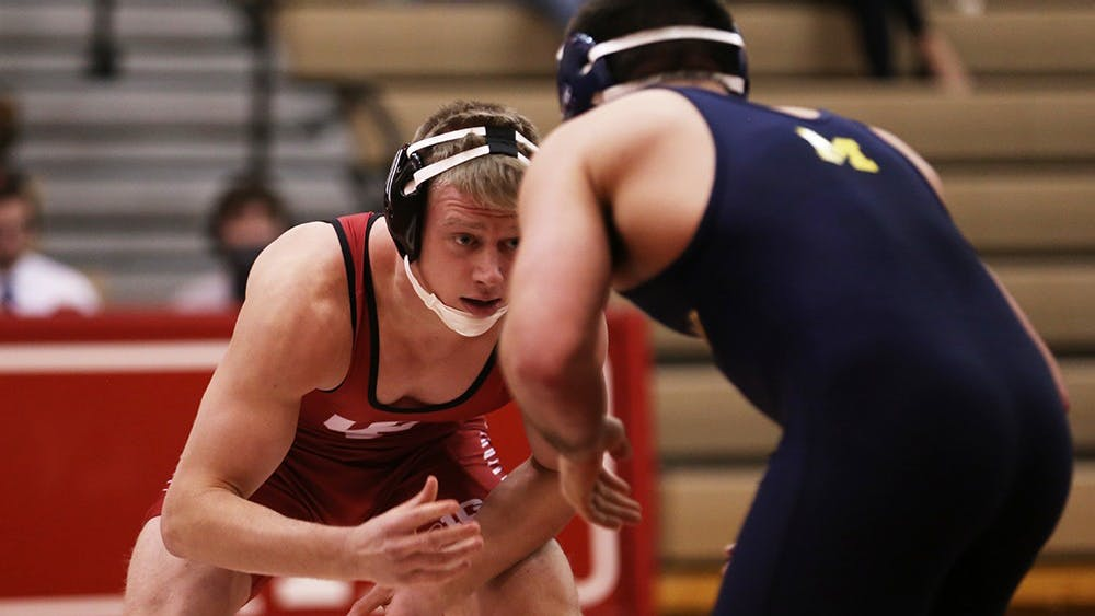 IU senior Taylor Walsh takes on Michigan sophomore Taylor Massa in the 165 lb. weight class during Sunday's wrestling match at University Gym.