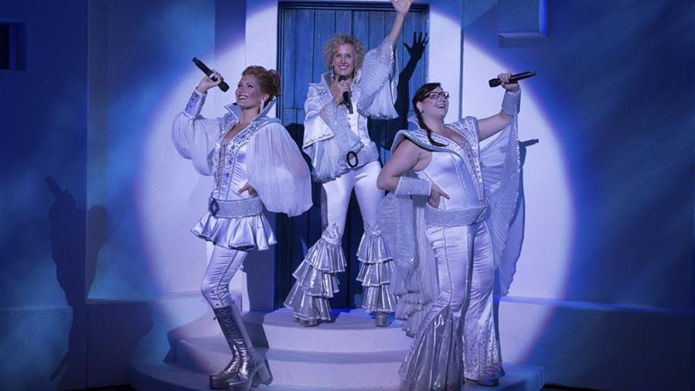 """Gabrielle Mirabella, Georgia Kate Haege and Carly Sakolove perform during """"Mamma Mia!"""". The musical will be at the IU Auditorium Dec. 6 and 7."""
