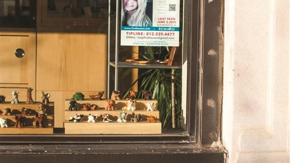 Missing posters for Lauren Spierer hang january 20 in downtown Bloomington shop windows. This year marks the third anniversary of the IU student's disappearance.