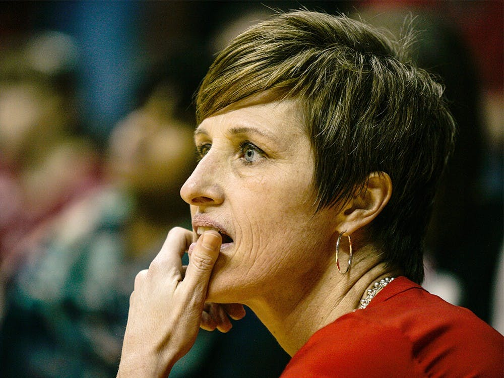 Head coach Teri Moren takes a knee at the edge of the court during the fourth quarter of play on Feb. 4 at Assembly Hall. The Hoosiers held on late to beat the Iowa Hawkeyes 79-74.