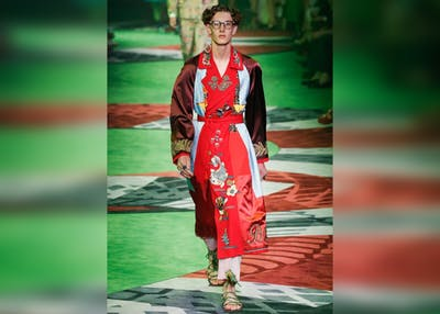 A model walks on the catwalk for Gucci on June 20, 2016, in Milan, Italy. This year's Milan Fashion Week begins Feb. 19 and ends Feb. 25.