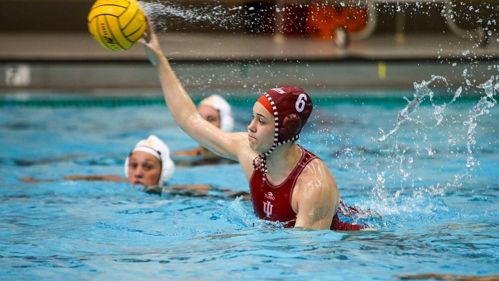 <p>Sophomore attacker Lanna Debow throws the ball April 2 at the Counsilman Billingsley Aquatics Center. IU water polo lost both of its matches with No. 4 University of California, Berkeley this weekend.</p>