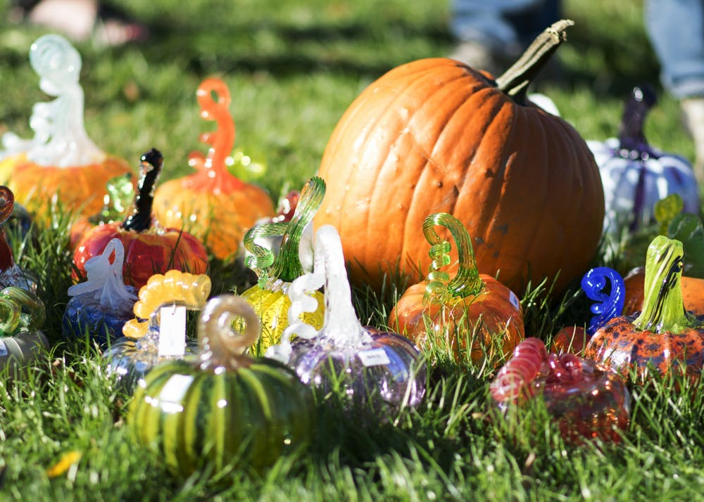 <p>Pumpkins rest on the lawn of the Monroe County Courthouse on Oct. 15, 2017, as part of the Great Glass Pumpkin Patch. The Bloomington Creative Glass Center creates more than 900 glass pumpkins to sell each year, with proceeds going to support a fully-equipped hot glass arts education center in Bloomington.</p>