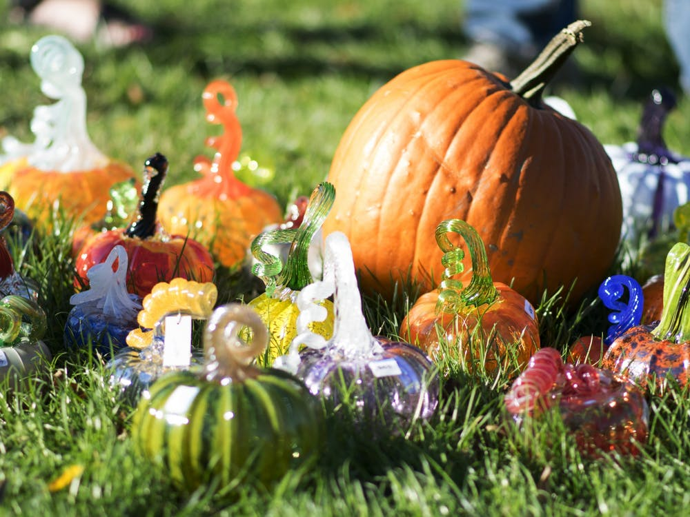 Pumpkins rest on the lawn of the Monroe County Courthouse on Oct. 15, 2017, as part of the Great Glass Pumpkin Patch. The Bloomington Creative Glass Center creates more than 900 glass pumpkins to sell each year, with proceeds going to support a fully-equipped hot glass arts education center in Bloomington.