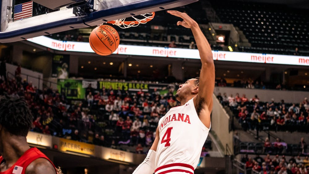 Freshman forward Trayce Jackson-Davis dunks the ball against Nebraska on March 11 at Bankers Life Fieldhouse in Indianapolis. IU was ahead of Nebraska at halftime.
