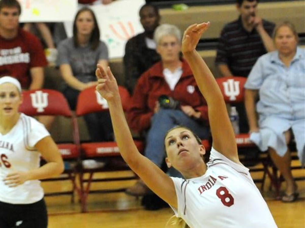 Sophomore setter Mary Chaudoin sets the ball during the September 18 match against Western Michigan.