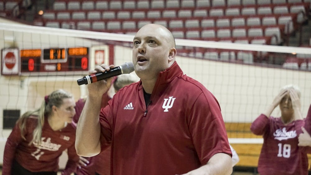 IU women's volleyball Head Coach Steve Aird hypes the crowd up for the annual Cream & Crimson scrimmage on Aug. 18. IU will take its 3-0 record to the Penn State Invitational this weekend.
