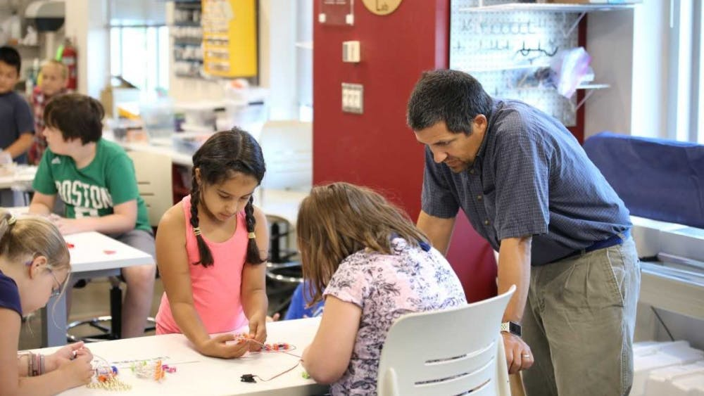 Adam Maltese, anassociate professor of science education, works with students at theMake, Innovate, Learn Lab Makerspace. Maltese is studying how women and young girls first get interested in STEM careers.