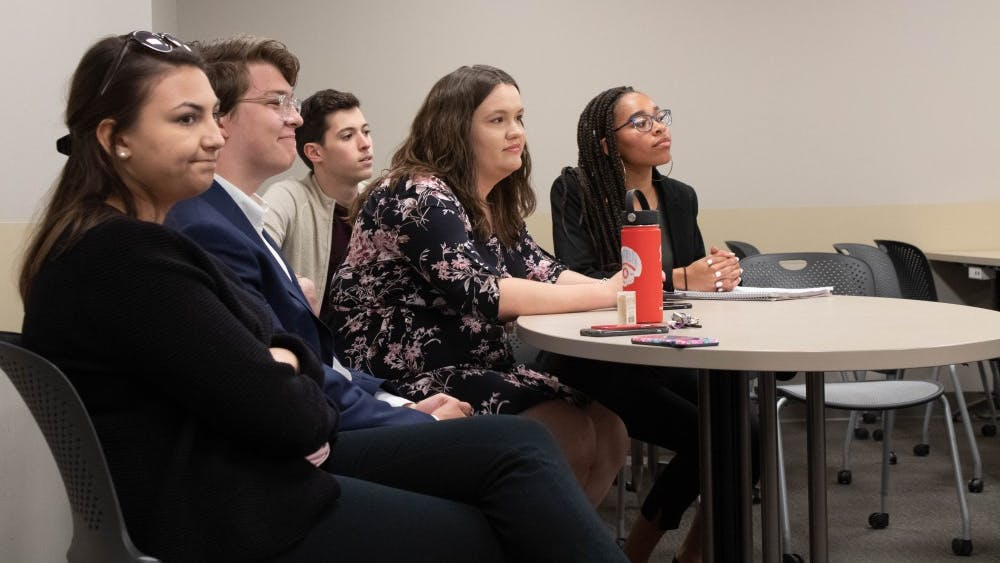 Students sit together April 28 to discuss leadership roles and executive branch duties in IU Student Government in the Kelley School of Business. IU Student Government represents the student body on campus.
