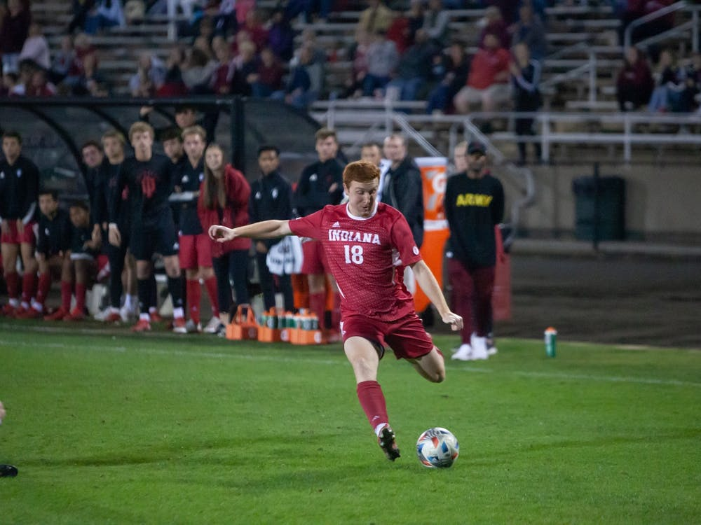 Junior forward Ryan Wittenbrink winds up for a shot on goal Oct. 20, 2021 in Bill Armstrong Stadium. Wittenbrink assisted on Tommy Mihalic's golden goal, which gave Indiana the lead in the Big Ten standings.