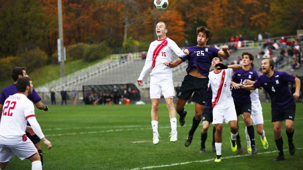Senior Andrew Gutman jumps to get a header during IU's 2-1 overtime win against Northwestern on Nov. 4 at Bill Armstrong Stadium. IU also beat Northwestern earlier in the season with the same score.