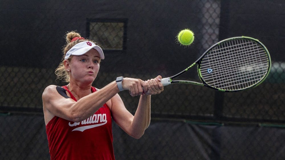 Redshirt senior Caitlin Bernard hits the ball following her opponent's serve Sept. 29 at the IU Tennis Center. IU will play the University of Alabama on Saturday in Tuscaloosa, Alabama.